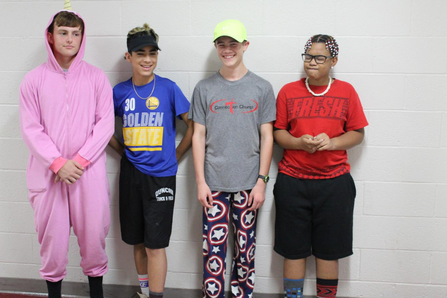 Peyton Roberson, Alan Mendoza, Eli Scott and Dominique Simmons show school spirit by showing what not to wear.