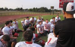 DMSs seventh-grade football players meet prior to Tuesdays game.