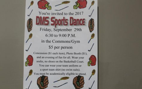 Poster, promoting the first dance of the year, are posted throughout the school.