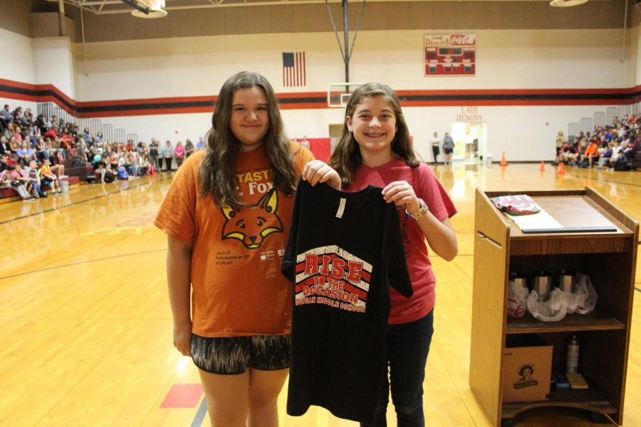 Sadi Blalock and Addison Siess, along with Gracie Reid, were recognized Thursday for being good representatives of the school theme, We rise by lifting others. The girls paid the Chromebook fee for another student.