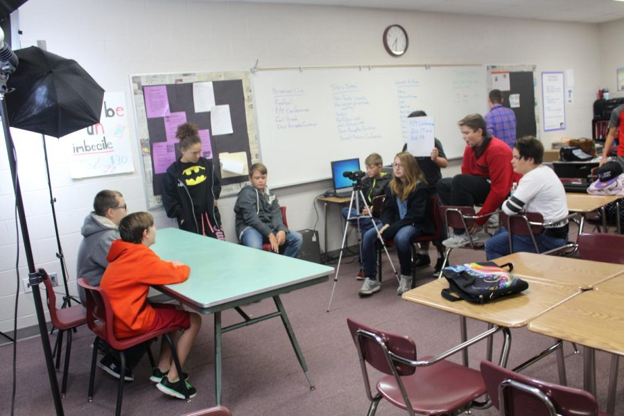 Members of the DMS Broadcast Club film a segment prior to school Wednesday.
