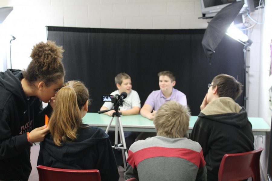 DMS Broadcast Club members work on the latest video news update.