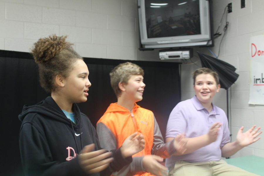 Broadcast Club members Asia Fleetwood, Jace van der Breggen and Brevin Hampton celebrate the Thanksgiving holiday with a sing-a-long.