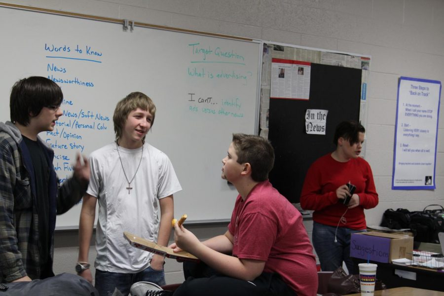 Members of the DMS Broadcast Club (Jack Baldwin, Trey Guernsey, Brevin Hampton and Acacia Luke) discuss what needs to be filmed.