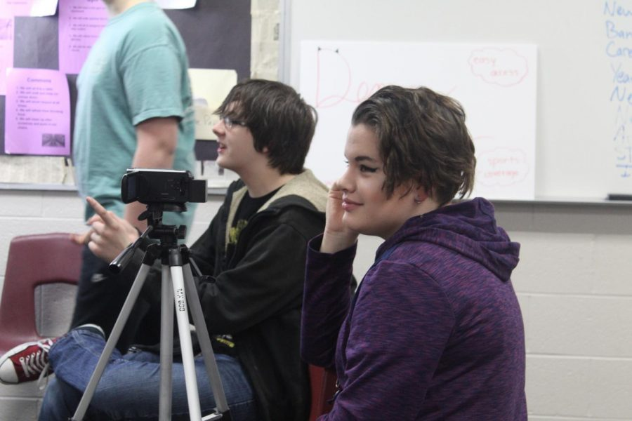 Jack Baldwin and Acacia Luke give direction during Wednesday's Broadcast Club meeting.