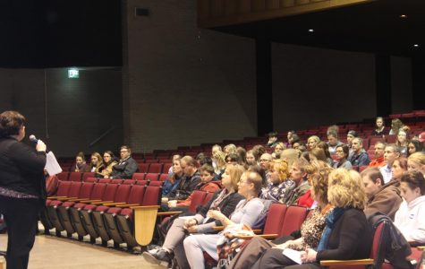 Eighth-graders attend high school enrollment meeting