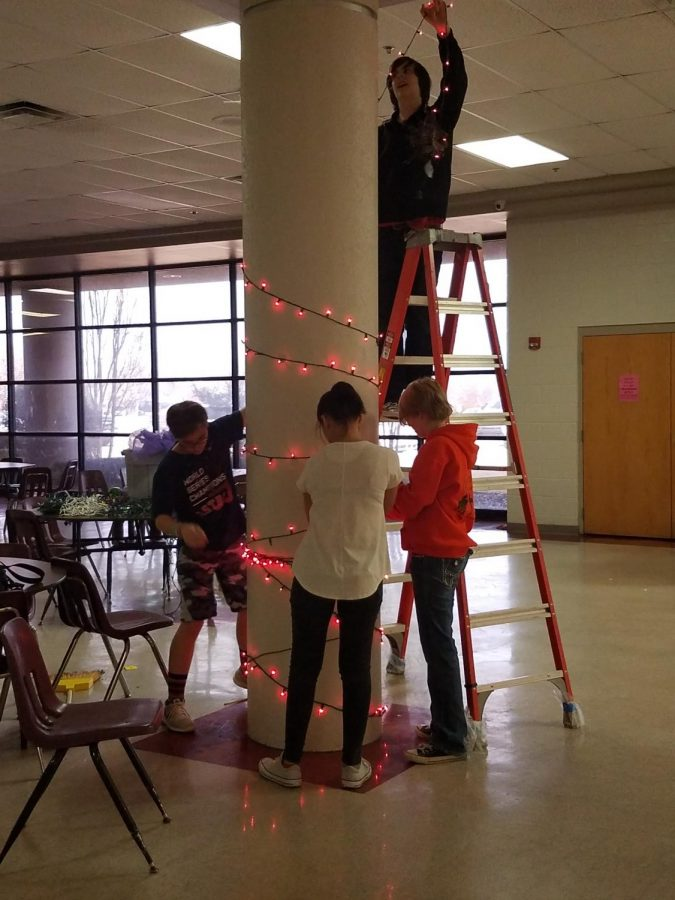 DMS choir students decorate for tonight's dance.