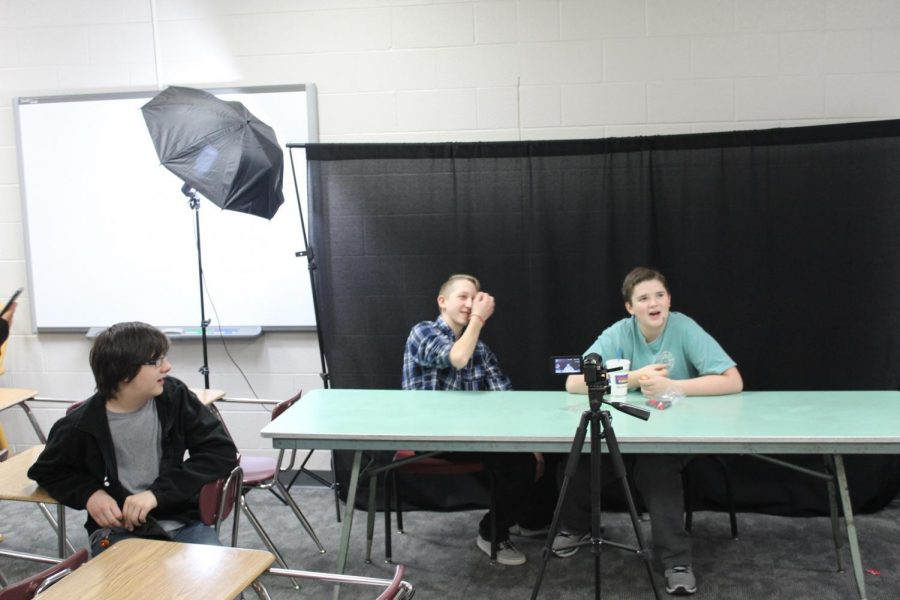 In this photo from February, Jack Baldwin watches as Trey Guernsey and Brevin Hampton record a segment for the weekly video news update.