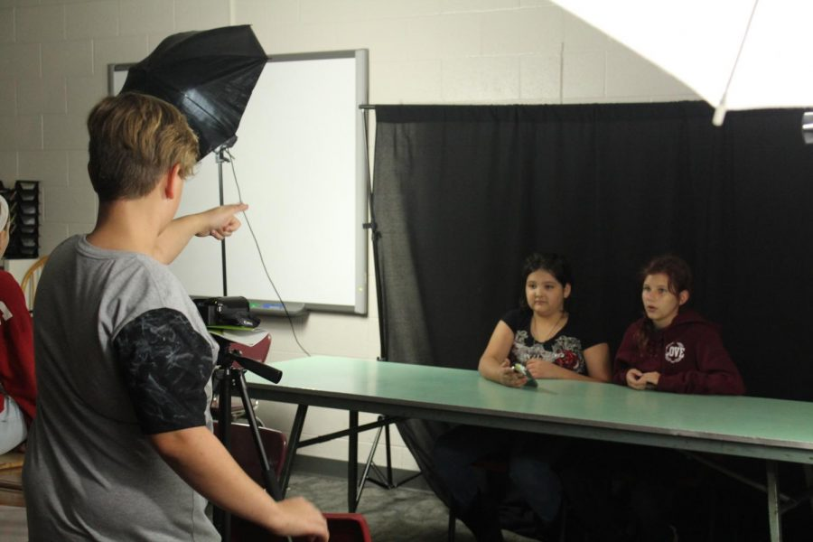 Ayden Heidler directs Ailana Hall-Satoe and Alex Stevens during Wednesday's Broadcast Club meeting.