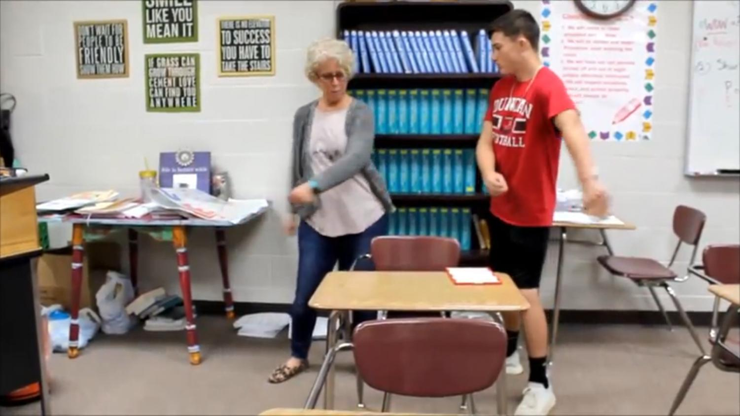 In this screenshot, Nathan Henry teaches English teacher Brenda Hurley how to dance the Floss.
