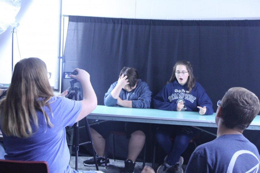 Dustin Finchum and Gabby Pilgrim prepare for their segment, while Kenzie Waggoner films with help from Aaron Taylor.