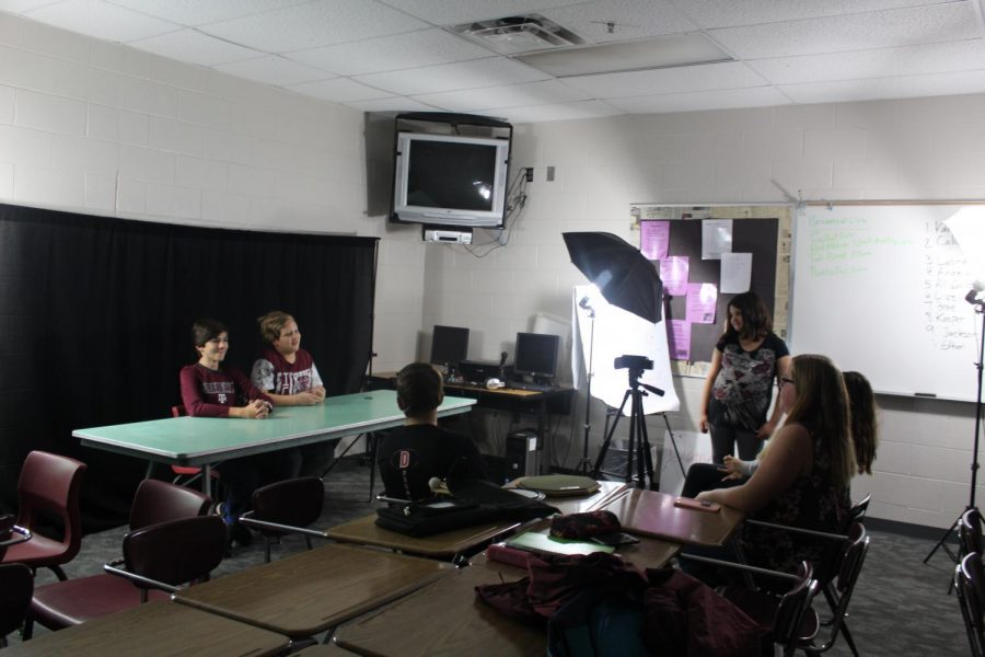 Broadcast Club members film the introduction for the latest DMS News Update.