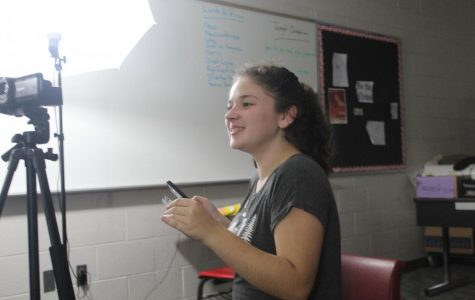 Maddie Caldwell records a segment of the latest DMS News Update.