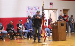 A banner was added to the background of the Veterans Day assembly.