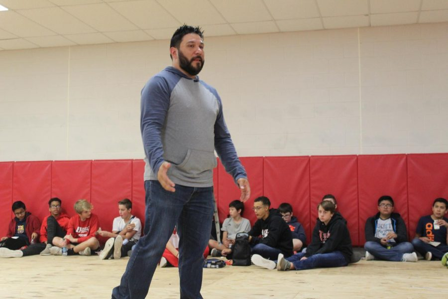 Roy Lanten talks to DMS eighth-graders today during FCA.