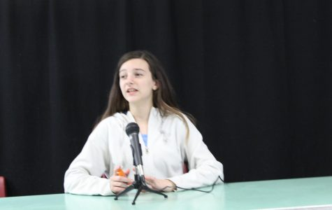 Grace Dean practices her podcasting skills during a Broadcast Club meeting.
