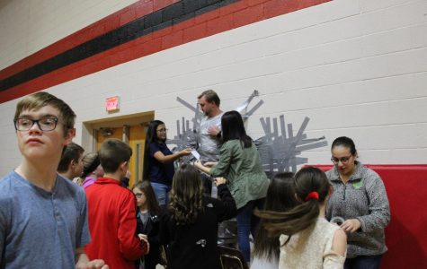 Student Council tapes Clark to wall