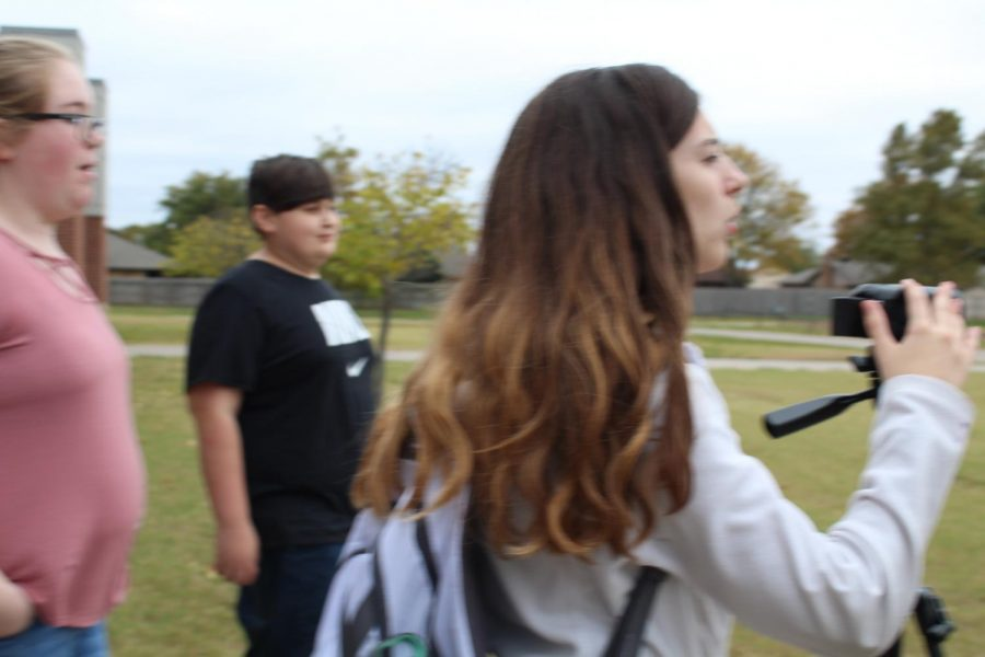 Grace Dean runs the camera with help from Kenzie Waggoner and Dustin Finchum during the weather segment of this week's DMS Video News Update..