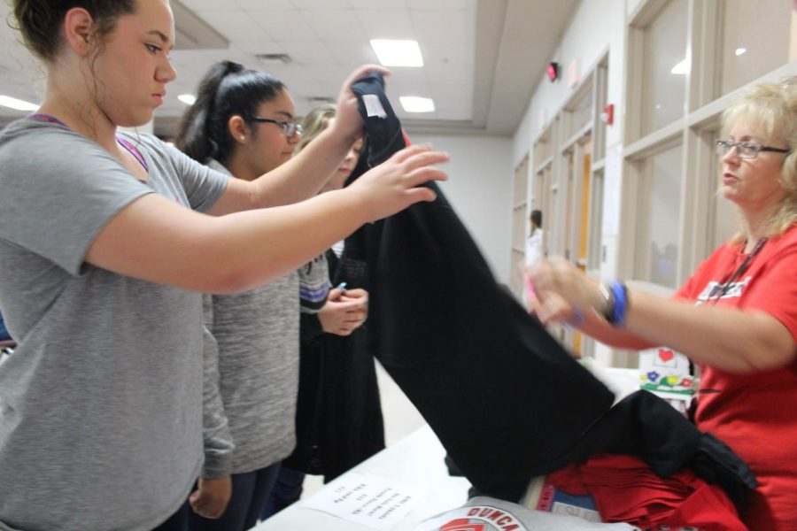 Jeanna Russell, Science Club, adviser sells T-shirts to raise money for Science Club in 2017.
