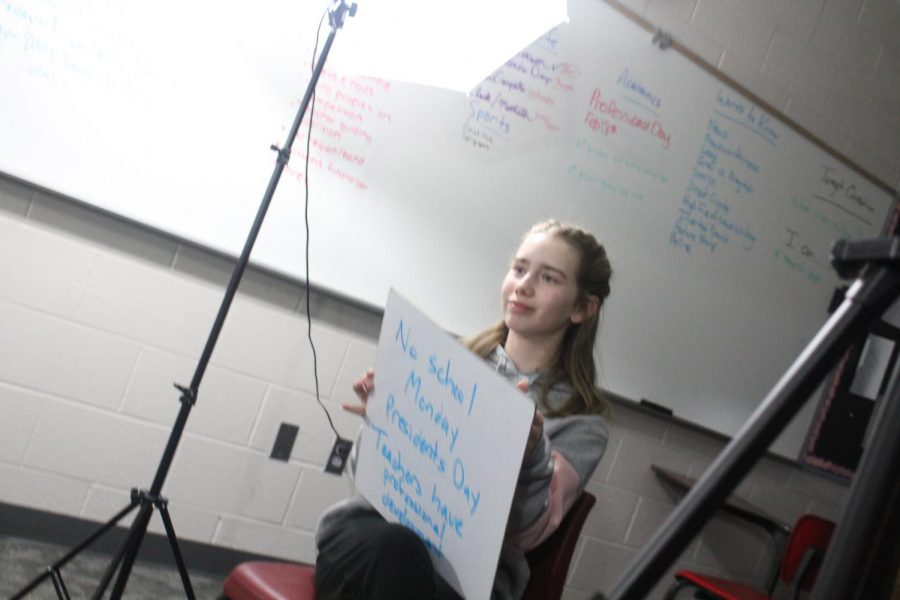Leona Cole holds a cue card for one of the segments of the DMS Video News Update.