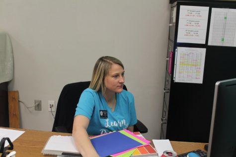 DMS nurse Kristin Akers works on her computer.