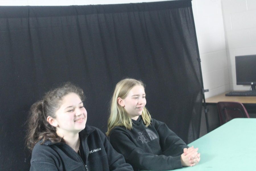Maddie Caldwell and Leona Cole talk about spring sports during Wednesday's Broadcast Club meeting.