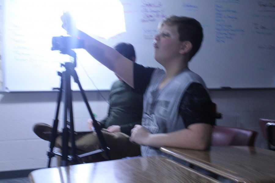 Ayden Heidler directs his fellow Broadcast Club members during Wednesday's filming session.