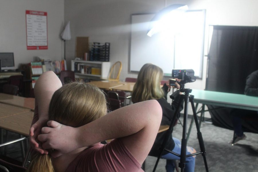 DMS Broadcast Club members film a segment for the weekly video.