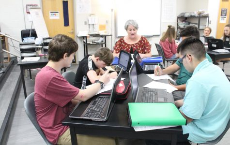 STEM teacher Rosie Castle works with students second hour today.