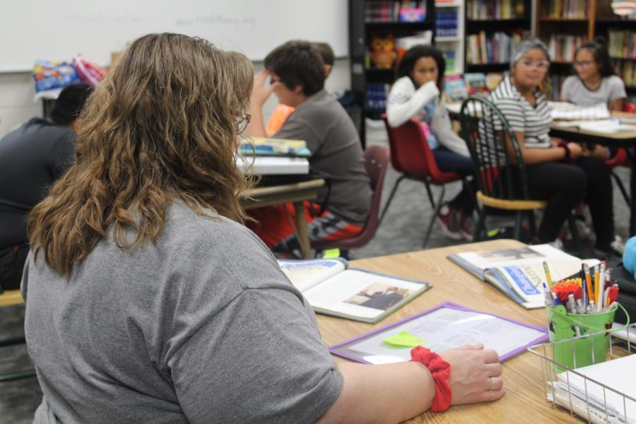 Sherry McGhghy works in her classroom Tuesday.