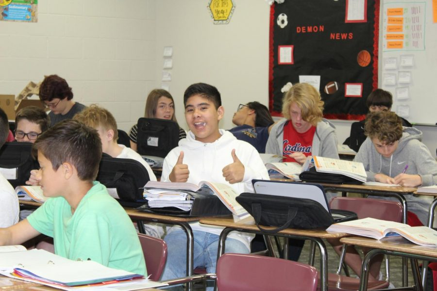 Jacob Morales gives a thumbs up during class.