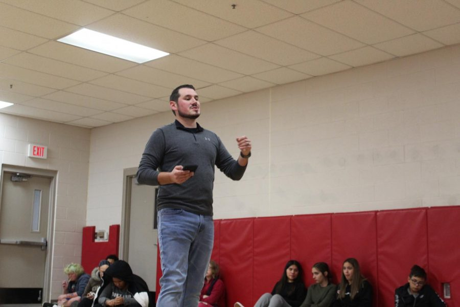 Tanner Zumwalt talks to eighth-grade students during Wednesday's FCA meeting.
