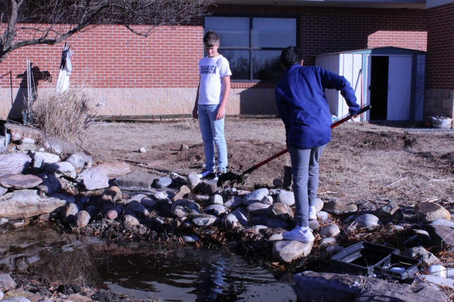 Kasper Hamilton and Tomas Arredondo work in the Duncan Middle School garden as part of the Green Clubs initiative.