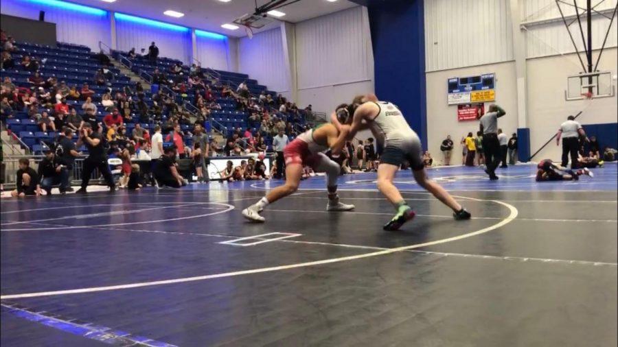 Eli Ramirez wrestles at tournament.