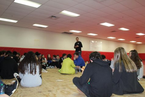 Richey Large, Southwest Oklahoma FCA represenative, talks with eighth-grade students Wednesday during FCA.