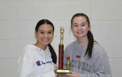Katelin Ramirez and Meg Walker pose with third place trophy.