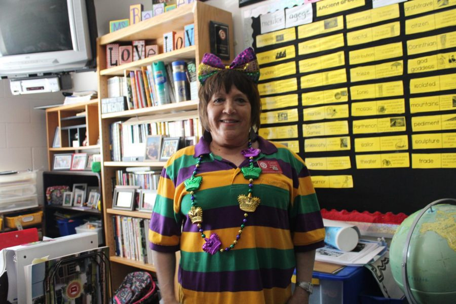 Cathy Barker shows off her Mardi Gras spirit by wearing green, purple and gold.