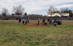 DMS Baseball players work on 2nd base.