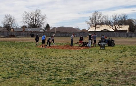 DMS Baseball players work on 2nd base.