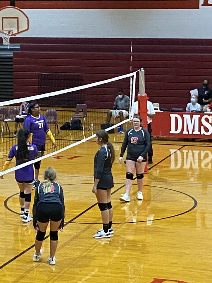 DMS volleyball girls face off against Lawton Ike. DMS ended up losing to the opposing team.