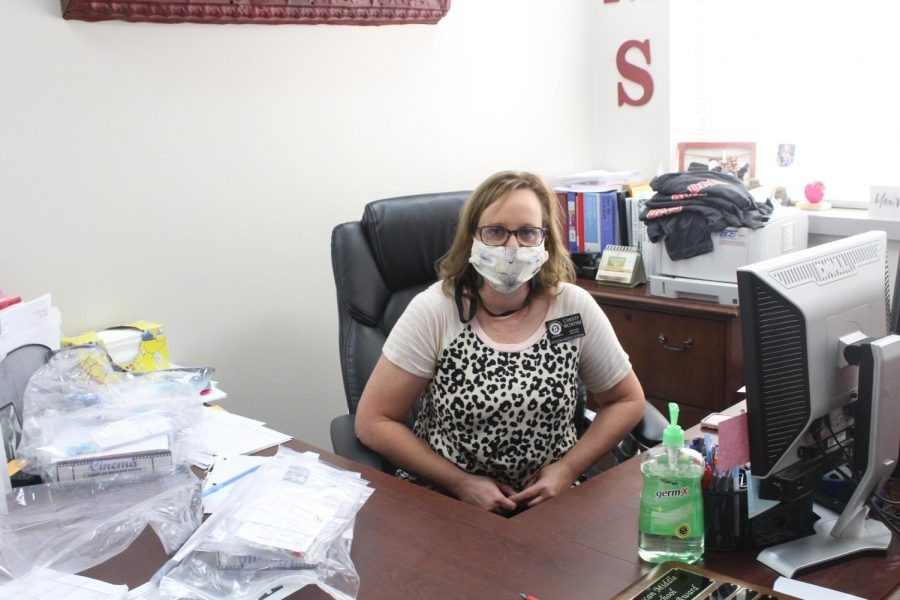 DMS Assistant Principal Christy McIntyre shows off her mask. This school year, the Duncan Board of Education mandated that all students, parents and teachers wear masks when entering any school site.