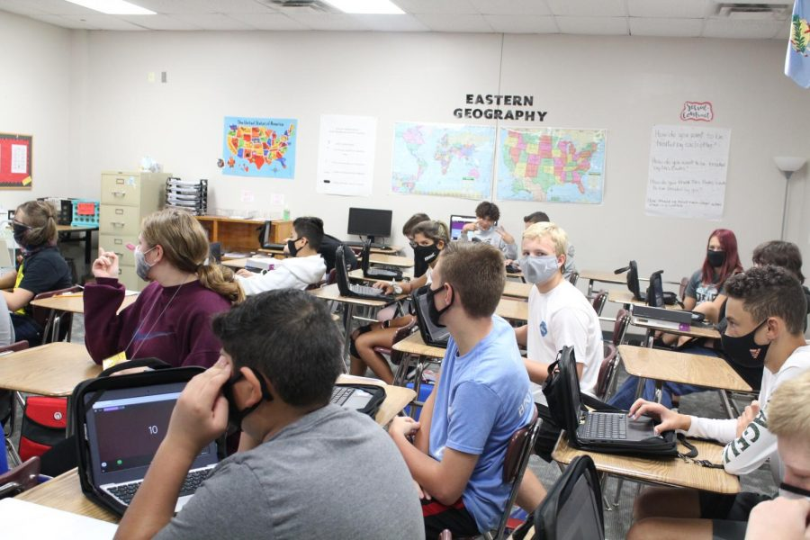 Seventh-graders use their Chromebooks in class. DMS added Digital Days this school year.