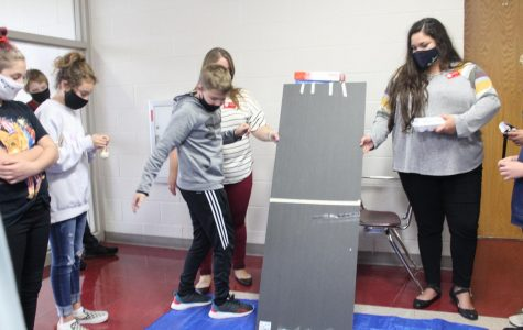 Seventh grade students participate in egg race during investigating science.