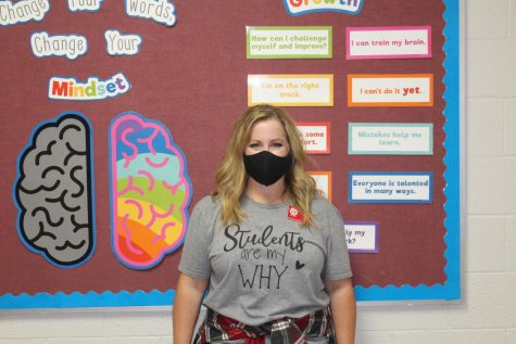 Marinda Cook poses for a photo in the sixth-grade hallway.