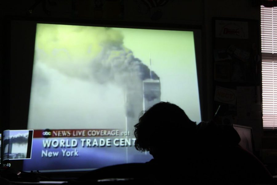 Students in Cathy Barker's room watch a news video of the World Trade Center terrorist attack.