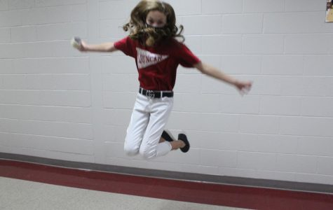 Presley Sanders shows off her cheerleader abilities in the hallway.