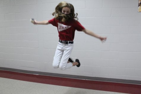Presley Sanders shows off her cheerleader abilities in the hallway.