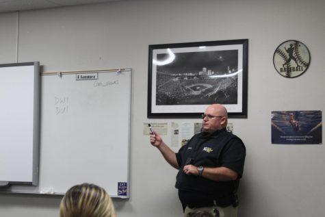 Officer Chris Perkins serves as a guest speaker for the health classes.