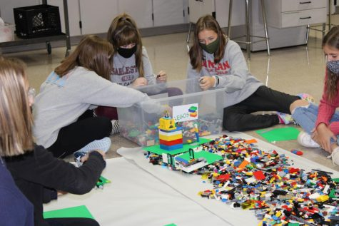 Eighth-grade students use Legos to design a prototype during Education Station.