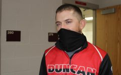 Justin Pena is the new wrestling coach for Duncan Middle School.